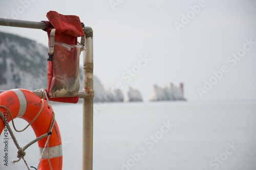 Canvas Print Lifebelt and emergency gear with the Needles, Isle of Wight, in background