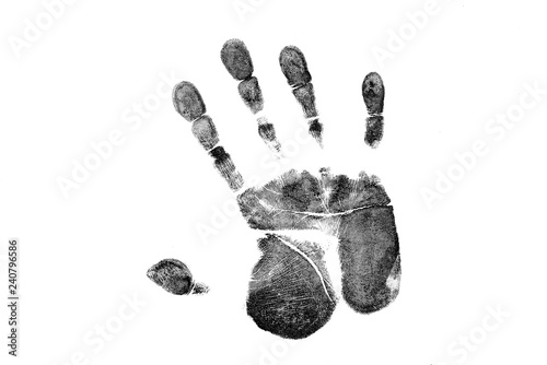 Fototapeta  Black prints of hand on transparent paper