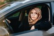 Middle eastern ethnicity woman in car as driver
