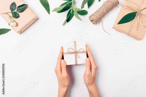 Fotografie, Obraz  Woman's hands holding small gift box