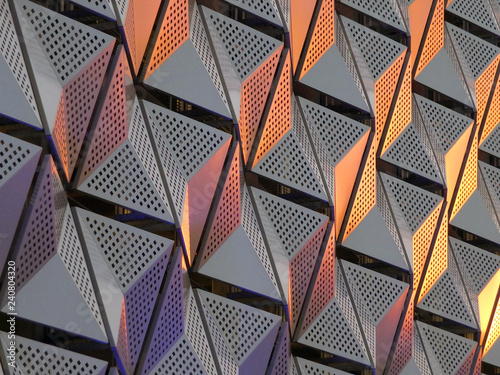 Fotografia, Obraz  modern geometric triangular shiny silver steel cladding with highlights in gold