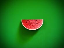 Red Watermelon On Green Backgr...