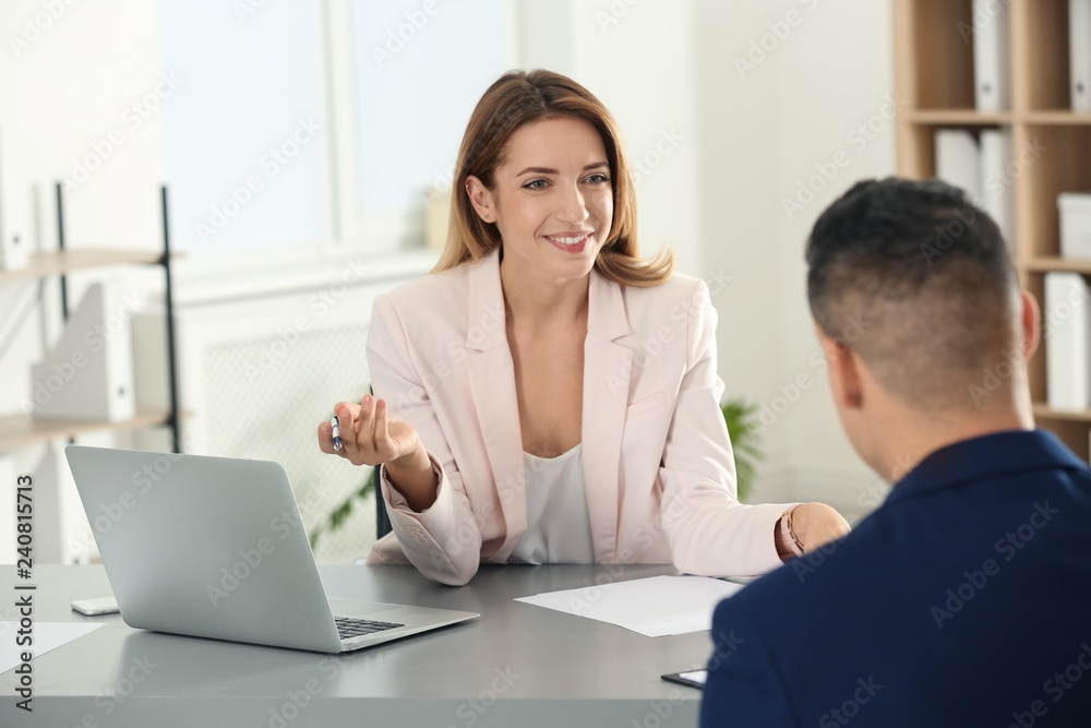 Fototapeta Human resources manager conducting job interview with applicant in office