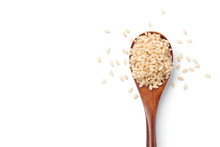 Brown Rice In A Wooden Spoon I...