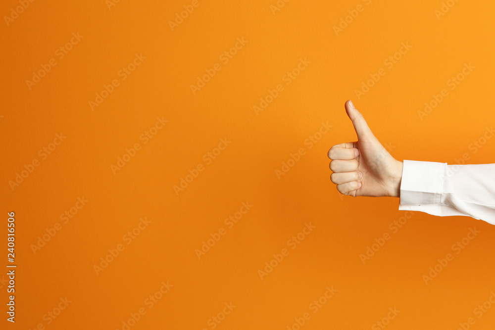 Fototapety, obrazy: Young woman showing thumb sign on color background. Space for text