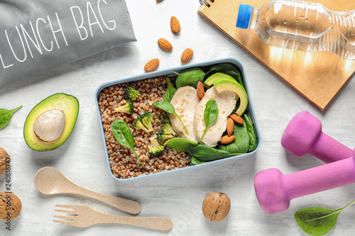 Flat lay composition with container of natural protein food on light background
