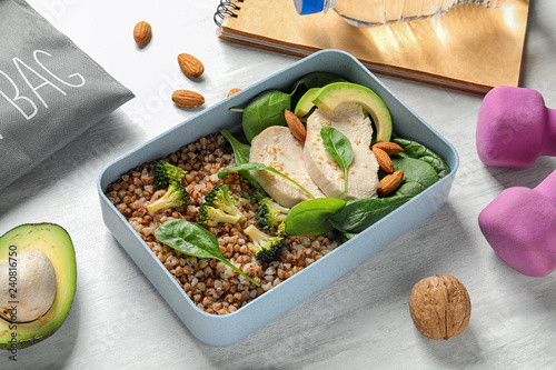 Container with natural protein food on light table