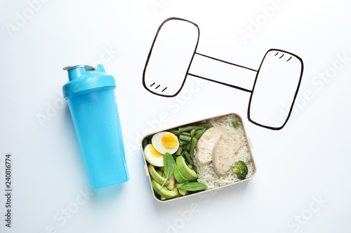 Flat lay composition with container of natural protein food on white background
