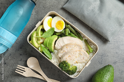 Flat lay composition with container of natural protein food on gray background