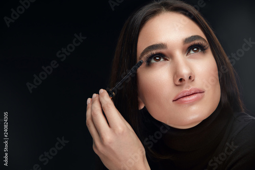 Valokuva  Mascara Makeup. Beauty Model Putting Black Mascara On Eyelashes