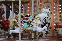 Carousel With Horses. Carousel Merry Go Round. Christmas And New Year's Holidays. Colorful Carnival Horses On A Merry-go-round Carousel