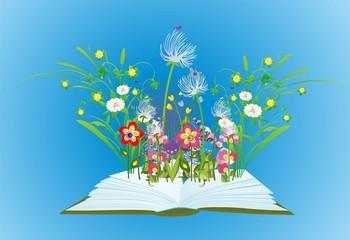 kompozycja z otwartą książką z której wyrastają kwiaty i trawa
