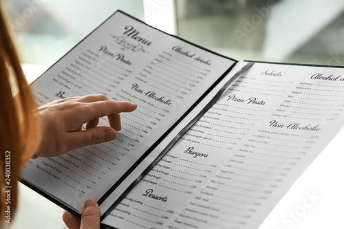 Fototapeta Woman reading menu in cafe, closeup obraz