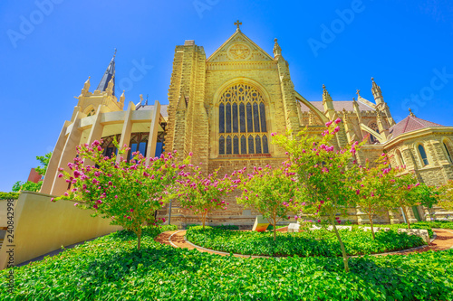 Staande foto Oceanië St Mary's Cathedral with stained glass in Perth, Western Australia. The flowery garden of Cathedral of the Immaculate Conception of the Blessed Virgin Mary in the neogothic style.