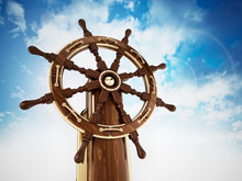 Ship Wheel Against Blue, Cloud...