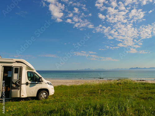 Camper van on sea shore, Lofoten Norway