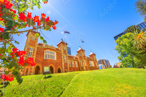 Staande foto Oceanië Bougainvillea in foreground with sunbeams in Government House Gardens, Perth city. Government House east front, the residence of Governor of Western Australia on background. Blue sky. Copy space.