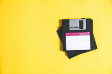Old Floppy Disks For Computer On Yellow Background
