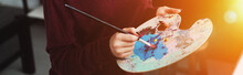 Partial View Of Girl Holding Paintbrush With Palette And Painting At Home With Backlit