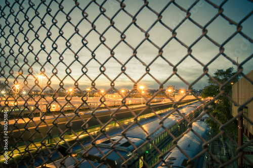 Many trains seen through chain link fence seen from New York City train yard in Canvas Print