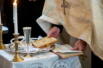 Detail shot of Greek Orthodox priest conducting wedding ceremony