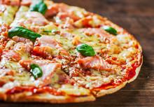 Pizza With Mozzarella Cheese, Salmon Fish, Tomato Sauce. Italian Pizza On Wooden Table Background
