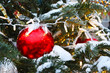 red Christmas ball, light bulbs, garland, snow, Christmas tree