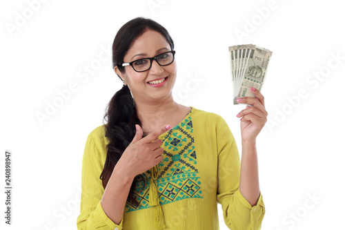 Fotografiet  Young woman holding Indian 500 rupee notes
