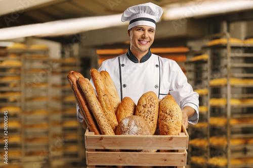 Baker holding a basket full of breads