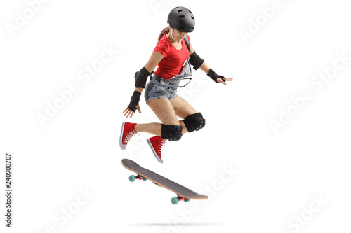 Female jumping with a skateboard