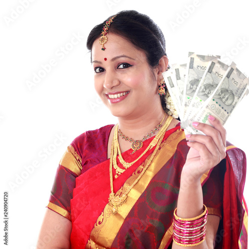 Fotografering  Traditional woman holding new 500 rupee notes