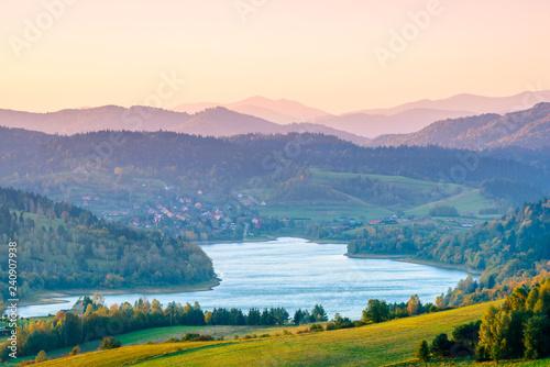 Foto auf Gartenposter Gebirge Polanczyk, Bieszczady Mountains, Poland: Sun rising over mountains. Views from near hill. In background Solina Lake.