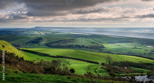 Panoramic view of Portand and Chesil Beach from the hill tops near Abbotsbury in Fototapet