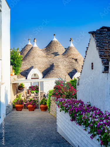 Vertical image, traditional trulli house in Alberobello village, tourist attract Wallpaper Mural