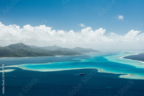 Canvastavla Aerial view on lagoon of Raiatea island in French Polynesia with blue and turquo
