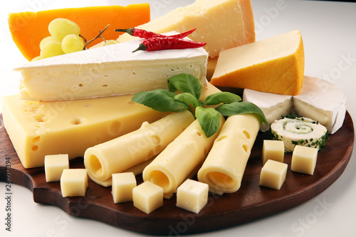 Cheese plate served with grapes, various cheese on a platter