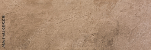 Photo sur Aluminium Cailloux ceramic brown tile with rough abstract stone surface pattern