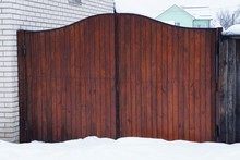 Big Brown Wooden Gate Boards Outside In White Snow