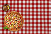 Whole Round Supreme Pizza With Coke Or Cola Glass On Red Tablecloth From Top View