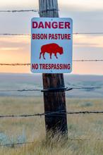 Bison Crossing Sign On A Wooden Fencepost In A Bison Pasture Near Swift Current, Saskatchewan
