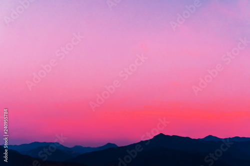 Mountain scenery view landscape with twilight sky beautiful magenta color tone theme sunset and sunrise background.