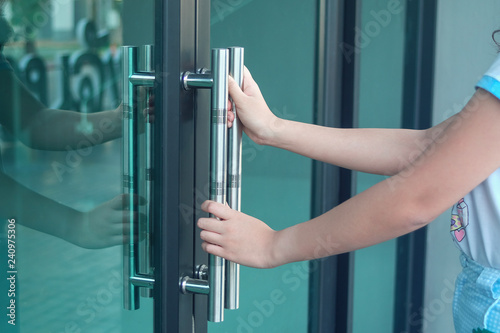Obraz hand hold a door handle to open office. - fototapety do salonu