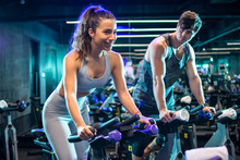 Young Sporty Couple Doing Spinning On Cycle Bikes