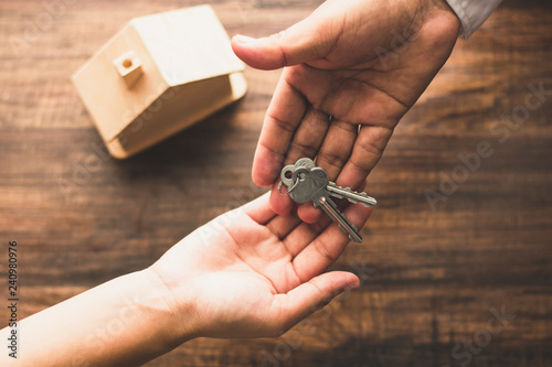 Fotografiet Real estate concept,top view of banker agency give house key to buyer