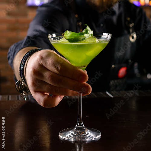 bartender serves ready-made cocktail in the bar