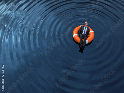 Fototapeta businessman are floating on the rescue buoys obraz