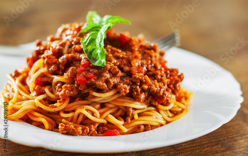 Traditional pasta spaghetti bolognese in white plate on wooden table background Fotobehang