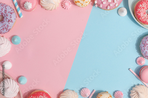 Foto Kitchen utensils and tools, pastries and sweets on a pink and blue background