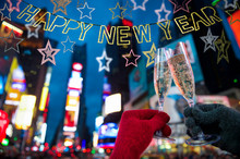 Happy New Year Message Hanging In Sparkling Silver Banner With Stars Above Romantic Champagne Toast Times Square, New York City