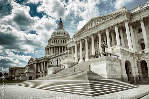 Stark cloudy weather over empty exterior view of the US Capitol Building in Wash Wallpaper Mural
